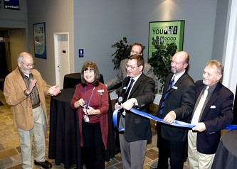OK, we're open for business!!  Goodwill president and CEO, Tim Welker holds the ribbon just after it is cut.