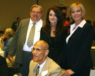 Dr. Randy Stith, left, Wendy Mitchell, Molly Hughes and Larry Davila (seated)