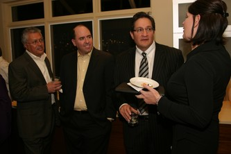 Vince Rosales from the Board, Rob McGovern, Ricardo Sanchez and Johnell Olsson talk over caviar