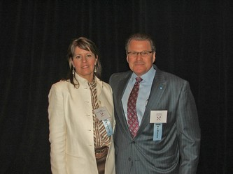 Goodwill Board Chair Carrie Mesch with past chair and Community Leader award winner Todd Munson