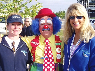 Volunteer chair Laurel Allen, left, and event chair Marie Adamson with happy clown Snazzy