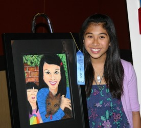 1st Place Winner, Isabella Ello (grade 7-8) with self-portrait