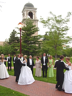 With the tolling of the bells in the Buchtel Tower, one for each of the debs, the traditional father-daughter waltz began