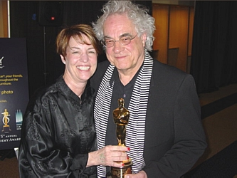Oscar-winning® Documentarian Donna Dewey and Denver Film Society's Artistic Director Ron Henderson posing with Donna's prized Oscar® statuette.  She won five years ago for her documentary, A Story of Healing.