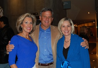 George Johnson, center, with the co-chairs of the event: his wife Gail Johnson, left, and former First Lady Frances Owens