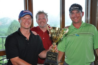 Winners Justin Smith, left, with Scott Smith, and Jason Nefs