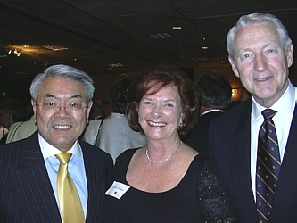 Honorary Chairperson John Sie, founder, chairman & CEO, Starz Encore, with Carol Saeman and International Bridge Builders Award recipient, The Honorable Hank Brown.