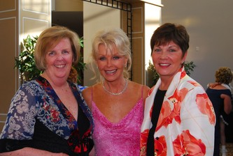 Gala Chairs Kaye Music, left, Linda Goto and Marsha Lunnon pose before the event begins