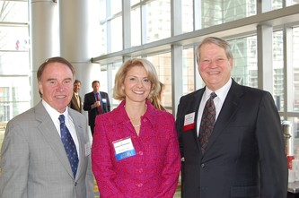 Bob Regan, President and CEO of JK Mullen High School, left, Outstanding Volunteer Fundraiser Kristin Richardson and Jack Alexander, President and CEO of the Helen K and Arthur E Johnson Foundation