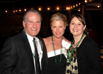 Board Member John Hanson (left) with Sue Mergen and Krista Keogh enjoy Vegas Night.