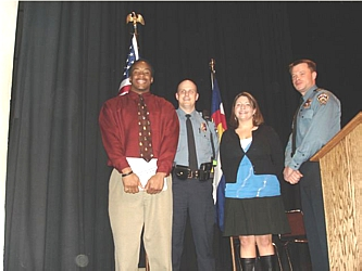 PAL graduate and former CU football star Bobby Purify, left, is joined by Sgt. Kirk Wilson, PAL Executive Director Liz Bratsky and Sgt. Creighton Brandt.