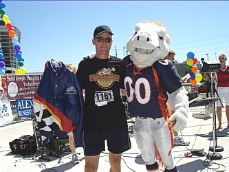 Dennis Scharinger, winner of the special Father's Day drawing prize, a beautiful NASCAR leather jacket, and a hug from Miles the Bronco