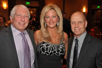 Craig and Layne Fleishman, left, with Scott Hamilton