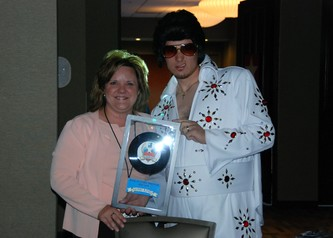 Sheri King receives the Rock-N-Roll Hall of Fame Goodwill Award, presented by the King himself.