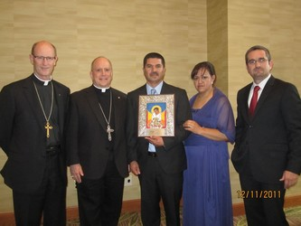 Bishop James Conley, left, Archbishop of Denver Most Rev. Samuel Aquila, Juan and Isidra Esquivel and Luis Soto