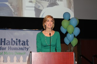 Emcee Cheryl Preheim addresses the crowd at the breakfast For Humanity.
