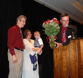 The Wheeler family accepts roses from Jim Barclay
