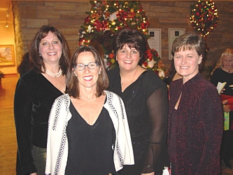 Karye Wilhelm, former Board President, left, Ginger Merelli Award Honoree Marilyn Dana, Board Member and Volunteer Chair Tami Lack and Board Member and Santa's Breakfast Chair Connie Wyckoff