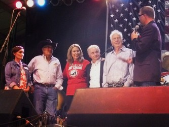 Marla and Steve Grove, TAPS founder Bonnie Carroll, Miles Cortez, Jake Jabs and emcee Steffan Tubbs