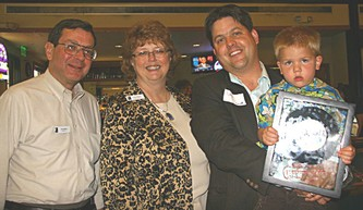 Goodwill President/CEO Tim Welker, Joyce Schlose and award winner David Pocs with son Lars
