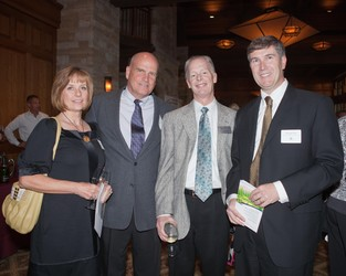 Marsha and Chuck Wahler with CEO Scott Thoemke and Michael Ellis