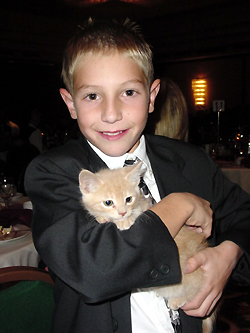 Tyler Chrisinger cuddles up with Leo, a tabby in need of a home