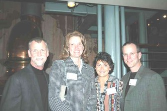 Event planners and enthusiastic supporters, Tom and Angie Belt, left,  with Greg Greenwood and his wife Tammy Sciortino