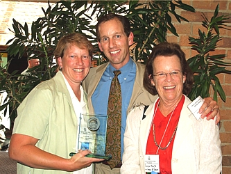 Allison Smith, with the American Lung Association, left, winner Gordon Smith with National Jewish, and Carolyn D. Smith, Development Coordinator of the Junior League of Denver Foundation.