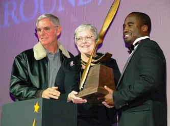 Dick Rutan, left, Peggy Fossett and Barrington Irving