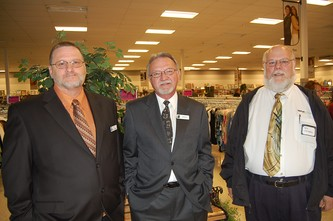 Proud store manager Scott Brethour, left, Jeff Ayers, Director of Retail Sales and Joe Michaels