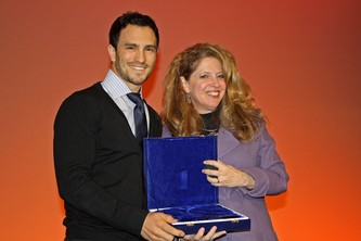 Erin Denholm, right, presents Jeremy Bloom the Legacy Award of Courage