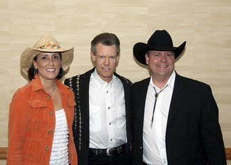 Randy Travis (center) with Julie and Ed Ammon, Executive Director, Porter Adventist Hospital Foundation