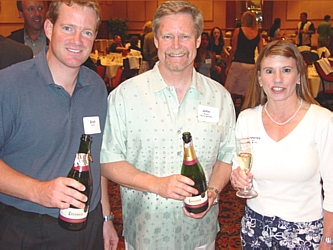 Brett Smith, left, with Board Members John and Kimberley Babel served up CAVA Codorníu for the first wine