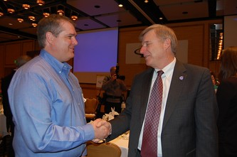 Community Hero recipient Chris Orloski, left, chats with keynote speaker Pete Earley