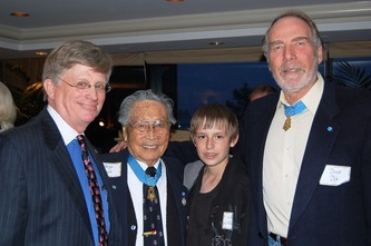 Honoree Tom Allee, left, Medal of Honor recipient George Sakato, Tom's son James, and Medal of Honor recipient Drew Dix