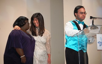 DeOndra Dixon and Michelle Sie Whitten look on as Sujeet Desai accepts the Quincy Jones Exceptional Advocacy Award