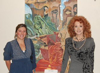 Artist Zoe Tessier, left, and Honorary Chair Judi Wolf stand in front of one of Zoe's unusual pieces, which will be available at Dine & D'art