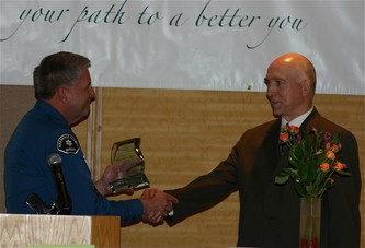 The Honorable William Blair Sylvester being presented with the Distinguished Service Award by Sheriff Robinson