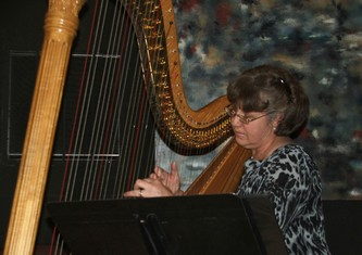 Harpist and RMCMA staffer Nancy Brace