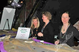 Safehouse staff and volunteers selling tickets and beads.