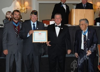 Jack Levinson, second from left, receives the Outstanding Veteran Service award
