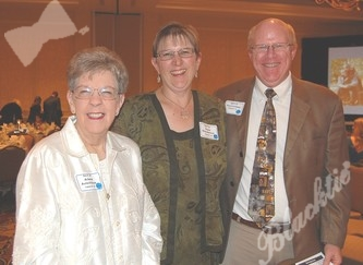 Arlene Avischious, former board member, left, with Paula Nickodemus and Paul Lindsey