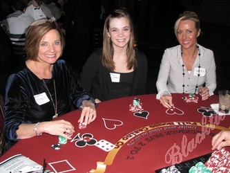 Sherri Hutcheon, left, Lindsey Hutcheon, and Desera Price try their hand at Blackjack