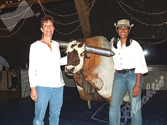 Ellen Wallace and Renu Poduval of SafeHouse with Ferdinand the Bull