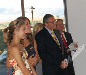 The Solich girls, Jim Shmerling and Steve Winesett listen as George and Carol Solich say a few words as event chairs