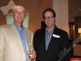 Retired golf professional Kevin Fonk, left, and Dean Prina, M.D. celebrate the announcement of the new fundraising event