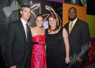 Adam and Kristin Reid, left, along with Catie Behnke and Joel Harris
