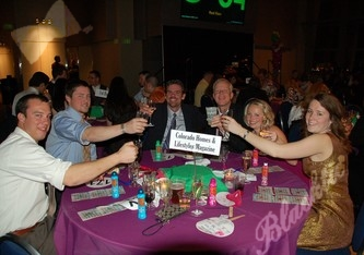 A toast before the games begin at the Colorado Homes & Lifestyles Magazine table