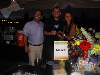 John Farnam with Michael of Catering by Design who served as bartender for Mezcal during the evening, and Patricia Peterson. Mezcal won the Margarita Challenge contest.