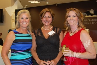 Board member Jennifer Churchfield, left, Stacy Loghry and Shawna Allen